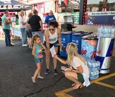 Photo courtesy of Citgo Miss Michigan 2017 Heather Kendrick (right) meets with attendees of Cambridge Citgo's Customer Appreciation Day Sept. 22.