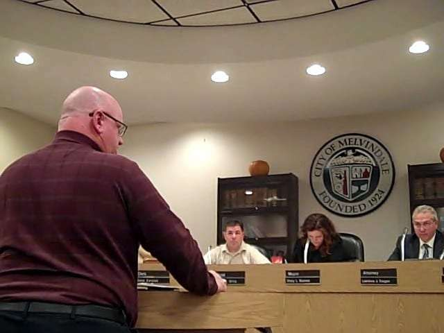 Photo by Sue Suchyta from video Community Development Block Grant Consultant Mark Kibby (left) explains to the City Council at its Nov. 1 meeting that 2016 Program Year funds not spent by Dec. 31 are forfeited, which motivated the council to transfer $45,000 in unspent funds from Community Code Enforcement to Public Facilities Improvement.